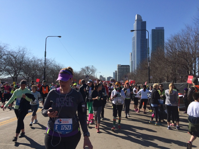 Runners finishing the Shamrock Shuffle, the world's largest 8K race, in March 2014.