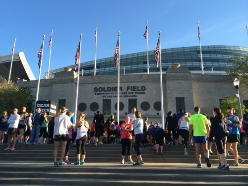 Runners gathering on the steps of Soldier Field before the Solider Field 10 Mile race.